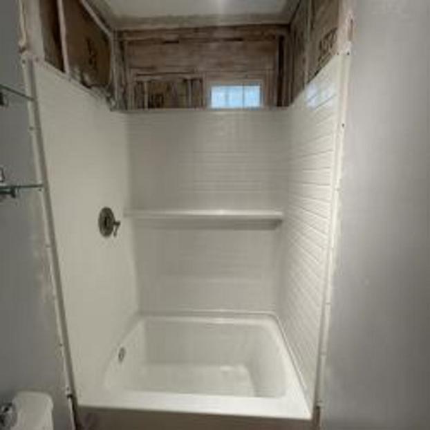 Final installation of fiberglass tub