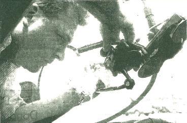 Technician performing repair Thumbnail