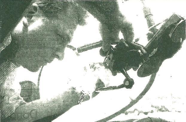 Technician performing repair