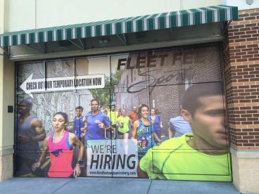 Temporary exterior wall vinyl for Fleet Feet Store Front Window in Mechanicsburg, PA