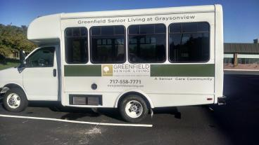 Vehicle lettering done with printed vinyl for Greenfield Senior Living in Mechanicsburg, PA