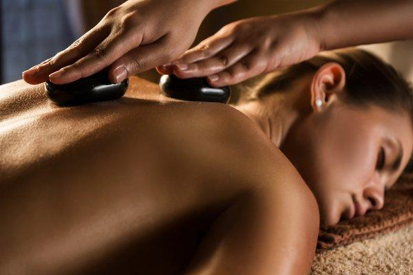 Our Signature Hot Stone Massage -  It's cold outside. Warm up with us!