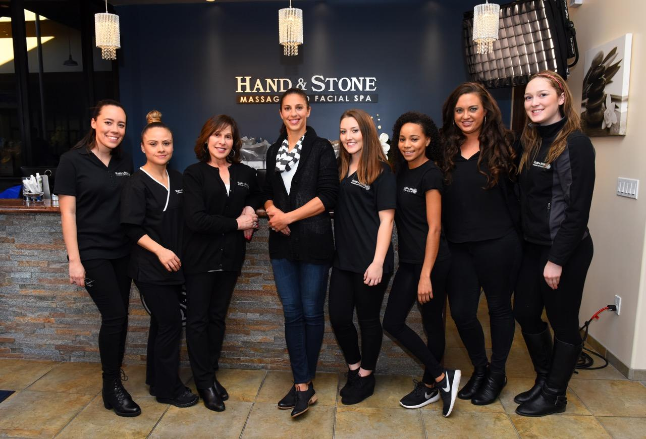 Carli Lloyd with some of the Hand & Stone Porter Ranch staff