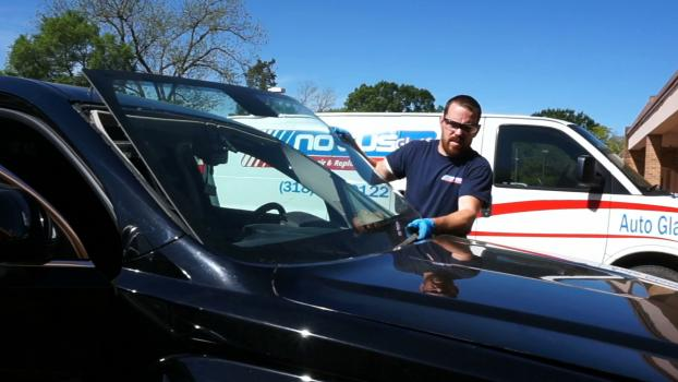 Removing old windshield in GMC