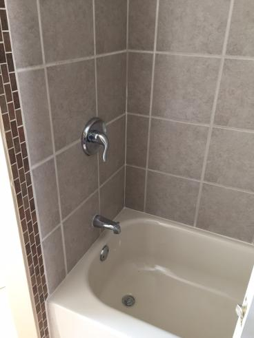Regrouted Shower Tile Wall Surround in Plains